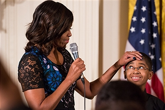 First Lady Michelle Obama addresses guests on stage with youth from the Sphinx Organization, who performed at the 2016 National Arts and Humanities Youth Program (NAHYP) Awards ceremony in the East Room of the White House, in Washington DC, on 15 November 2016. Photo by Cheriss May/NurPhoto.