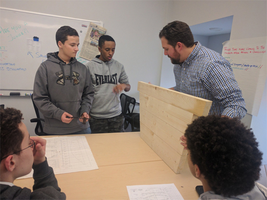 Boat building by New Bedford Whaling Museum's High School Apprenticeship Program participants