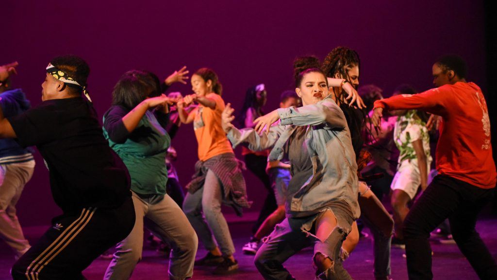 """Students performing their original play, """"Illuminate,"""" at Destiny Arts Center in Oakland, Calif."""