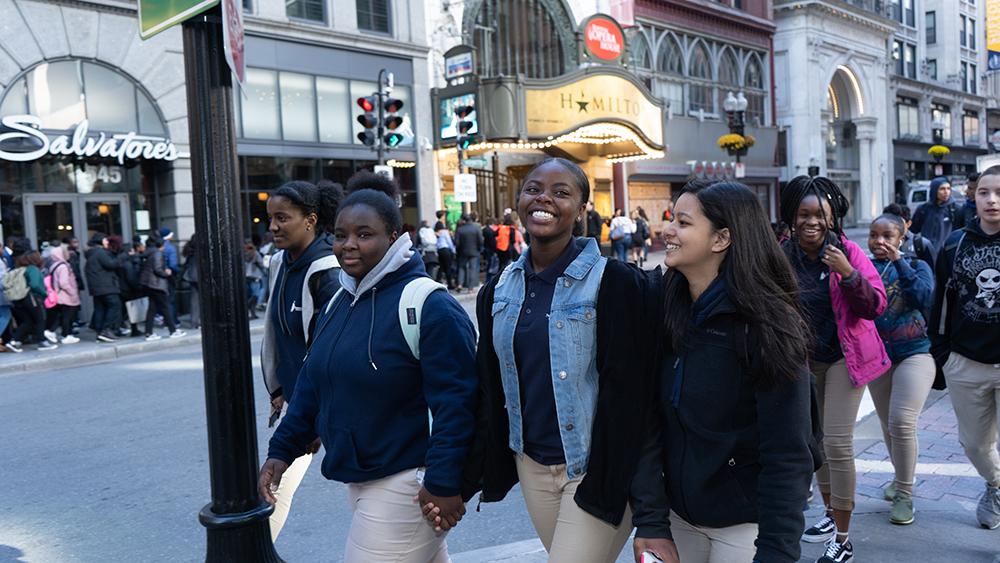 Young women walking to Boston Opera House to see Hamilton